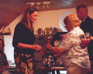 Emma Bunting accepts the Novice Cup on behalf of Pippa Taylor (who won in Emma's boat, My FFair Lady)