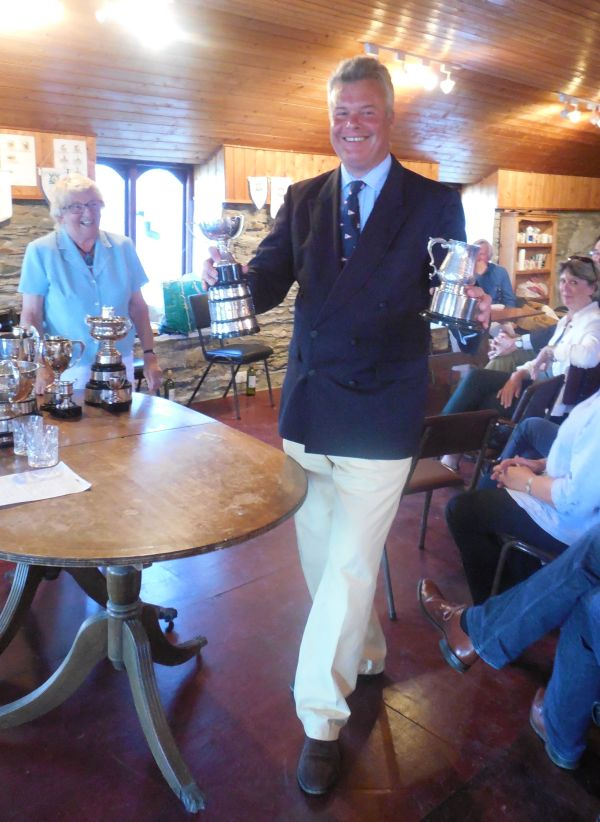 Mike Toogood shows off the Wayfarer Singlehanded Cup and the Overall Singlehanded Cup